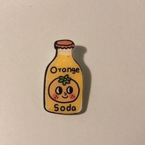 Orange soda pin